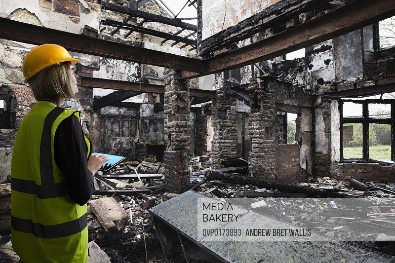 Insurance assessor inside fire damaged property
