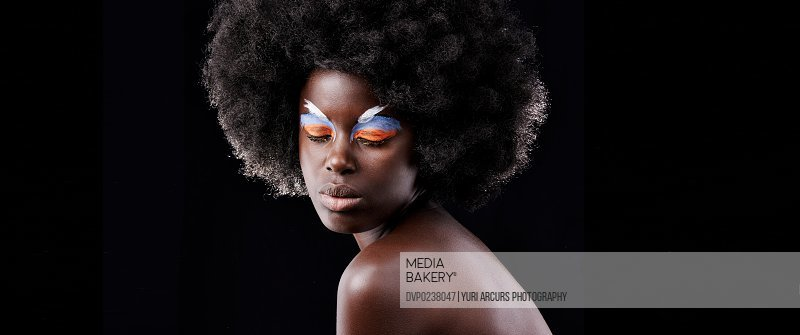 A beautiful model poses with colorful eyeshadow