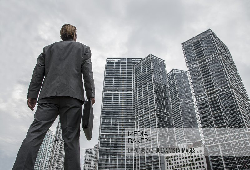 Businessman watching high building