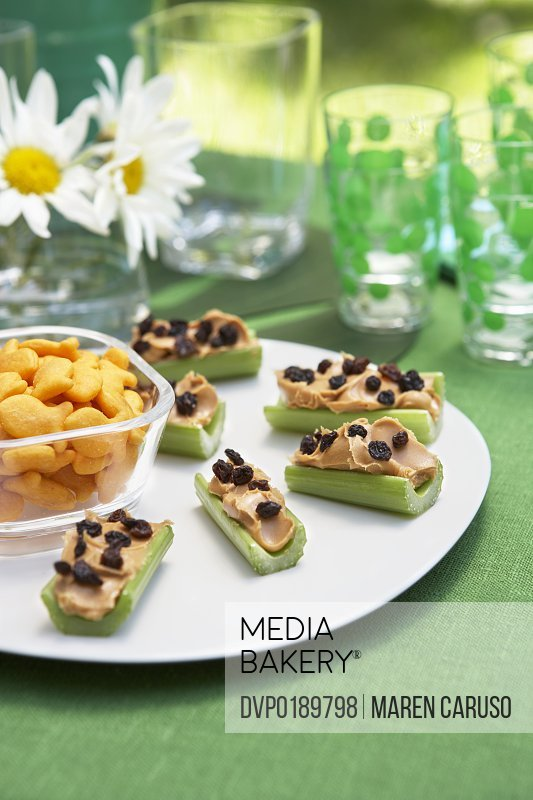 Celery with peanut butter and raisins with snacks