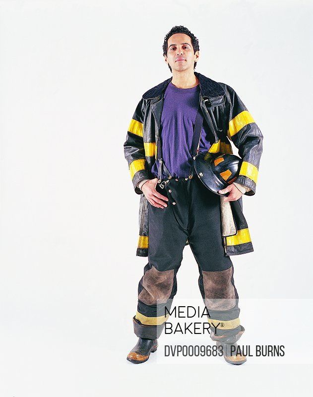 Portrait of a Firefighter Holding His Hard Hat