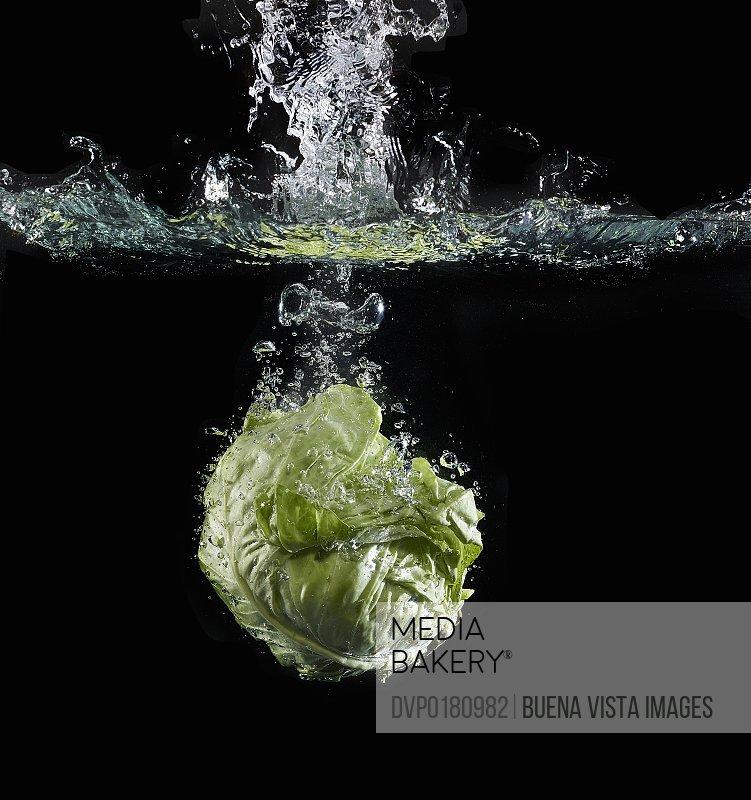 Lettuce splashing in water