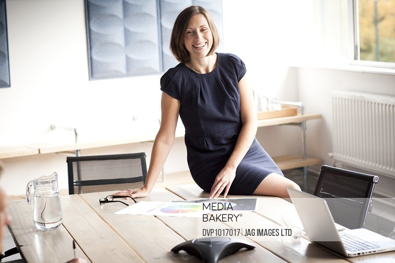 business woman sitting on her desk