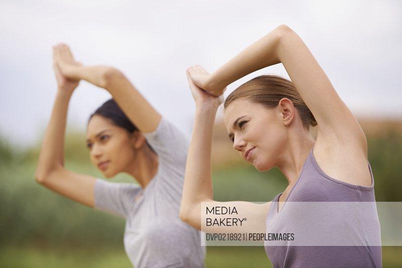 Women doing yoga outdoors