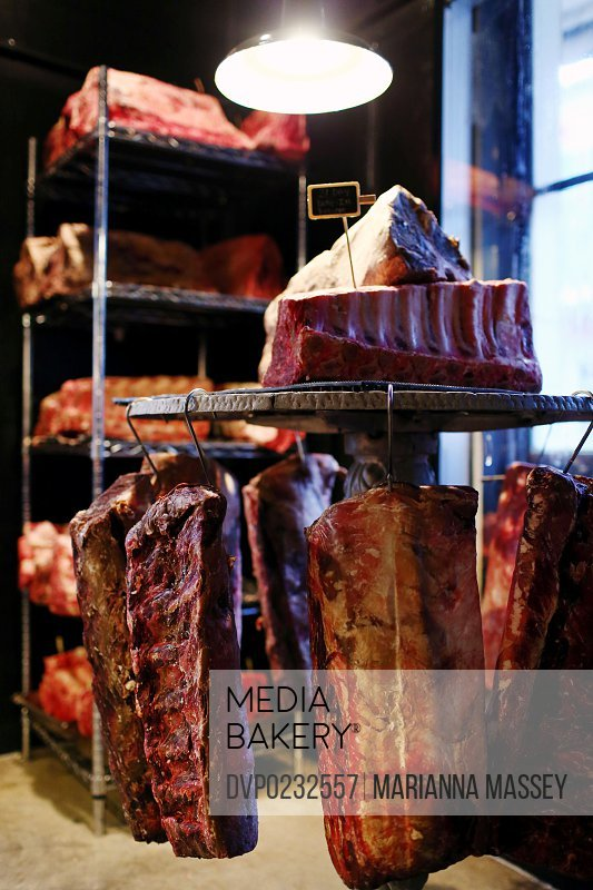 Cuts of gourmet meat in a cooled room at a fine dining restaurant