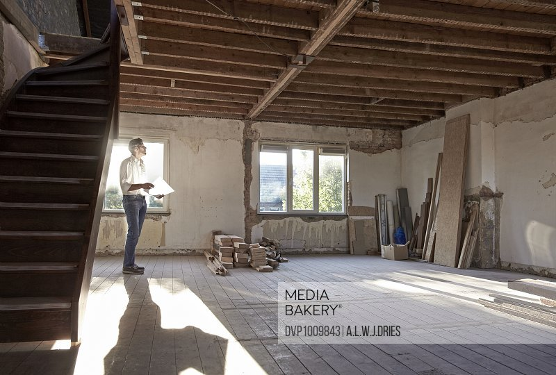 Man in old house before renovation