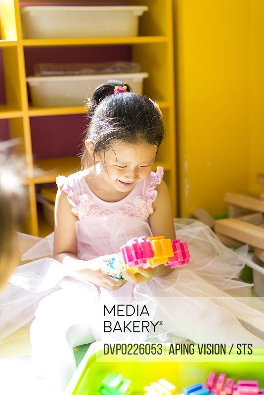 little girl playing in kindergarten