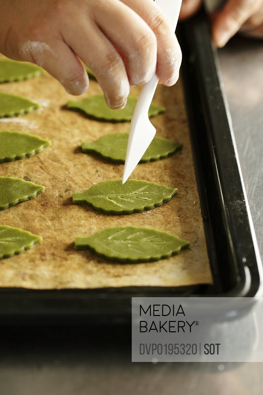 Cookie dough of form of leaf on oven tray
