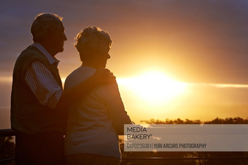 Cropped shot of an elderly couple looking at the view at sunset