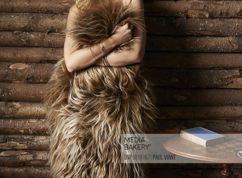 young woman covered in sheepskin