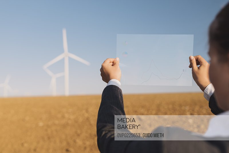 Businesswoman and wind turbine