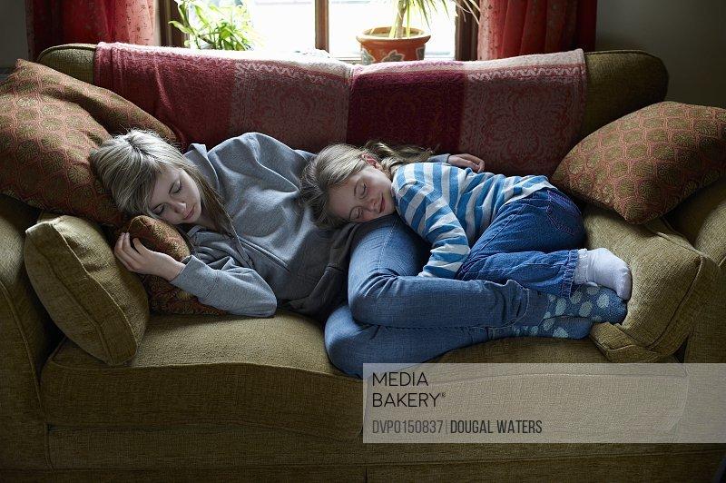 Sister asleep on sofa.
