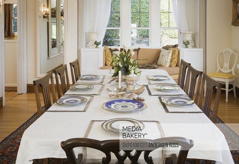 Place settings atop table in dining room