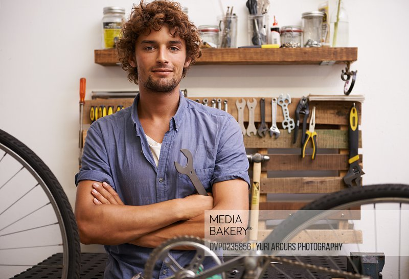 Shot of a confident young bicycle repairman looking at the camera