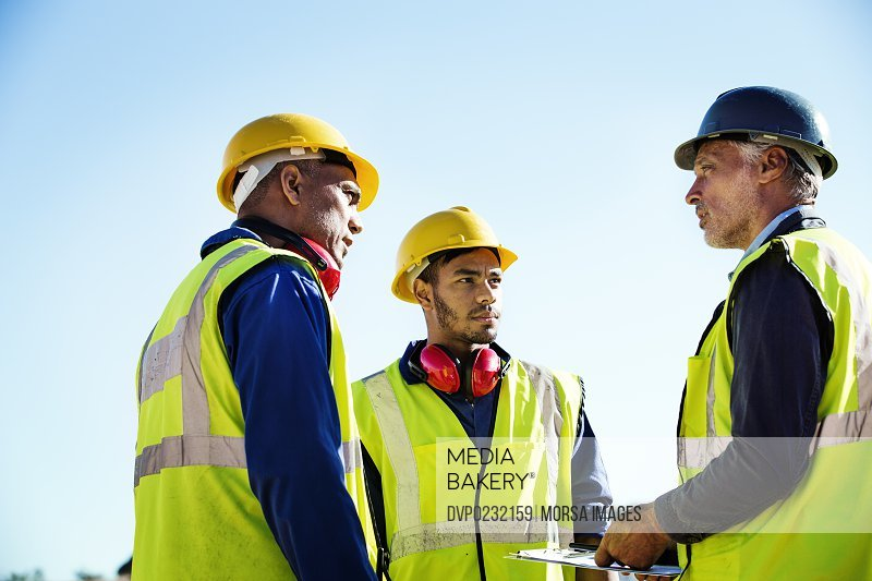 Architect discussing with quarry workers
