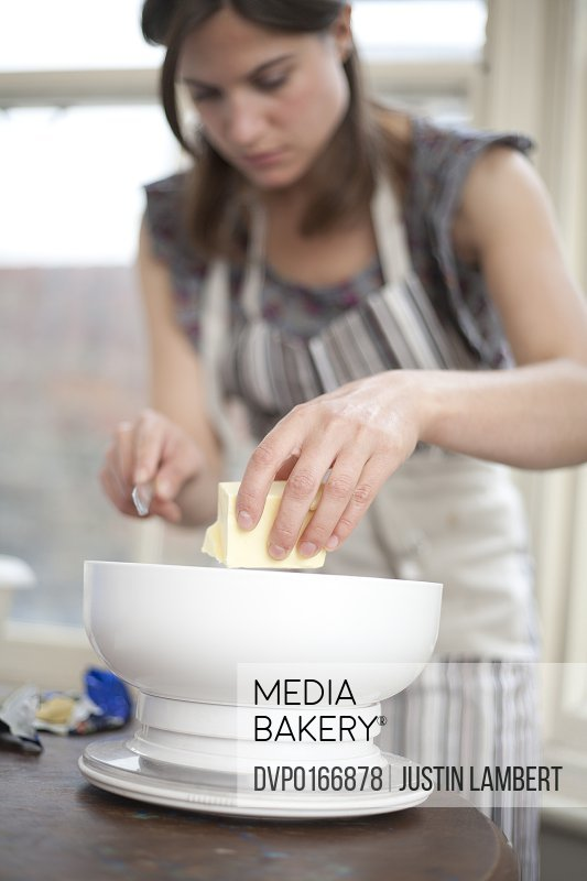 Girl weighing out butter