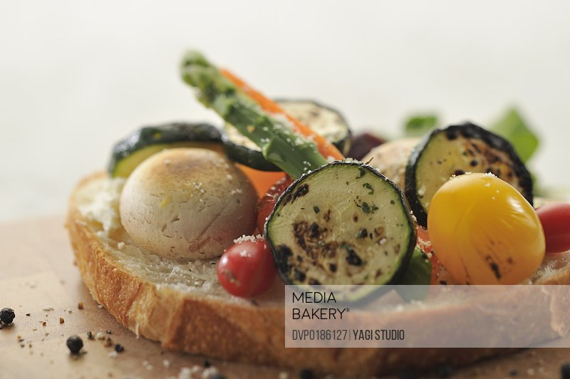 Organic vegetable open sandwiches on cutting board