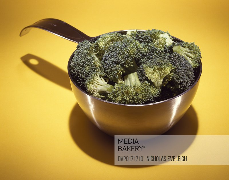 Measuring cup with broccoli