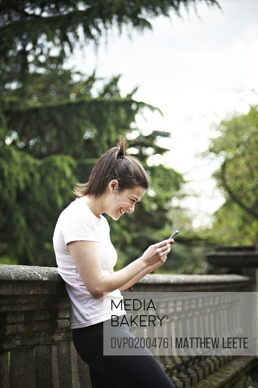 Female texting in park