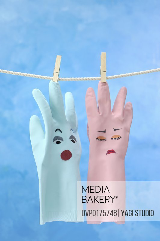 Two plastic gloves with the face
