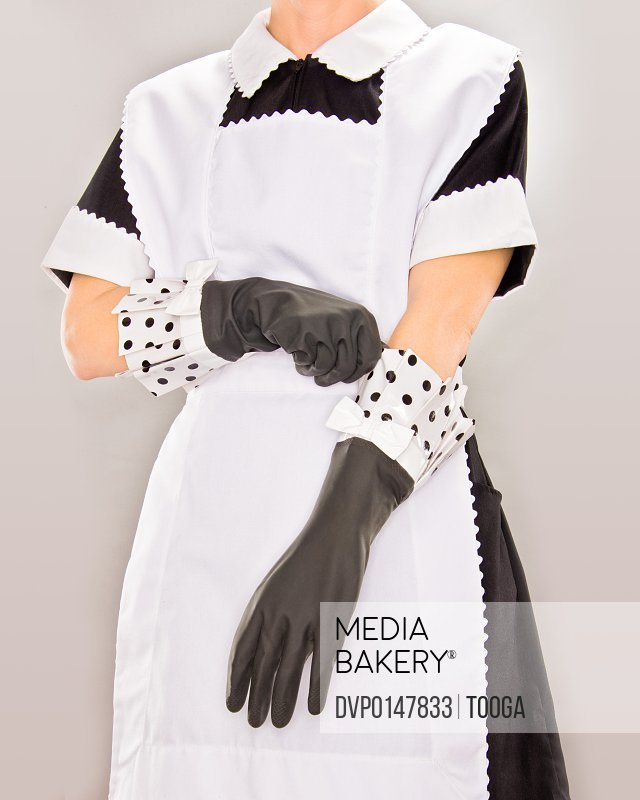 Maid putting on rubber gloves