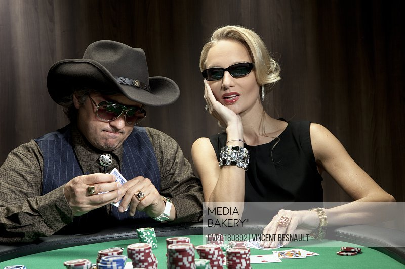 a woman and a man playing poker