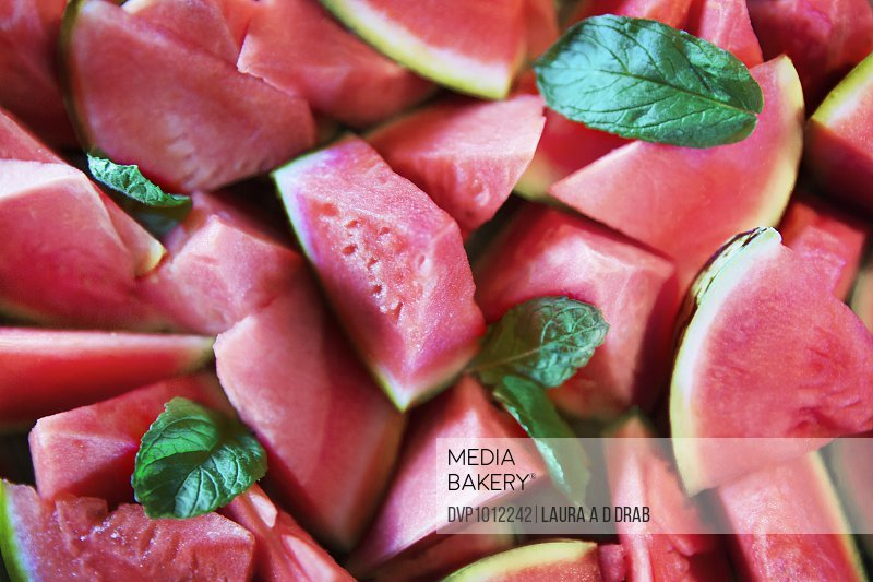 Watermelon pieces salad and mint leaves from above