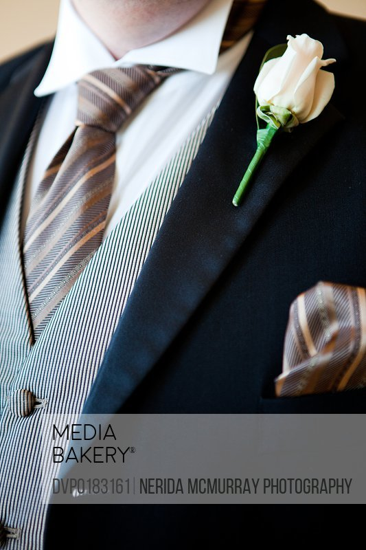 Grooms buttonhole suit detail