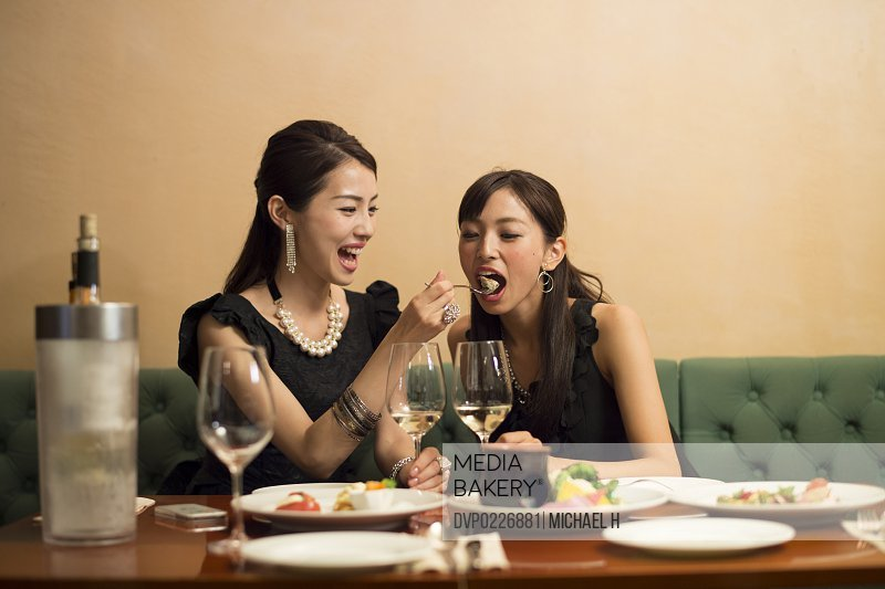 Two girls having fun in party atmosphere