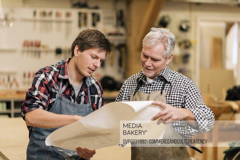 carpenters in wood workshop