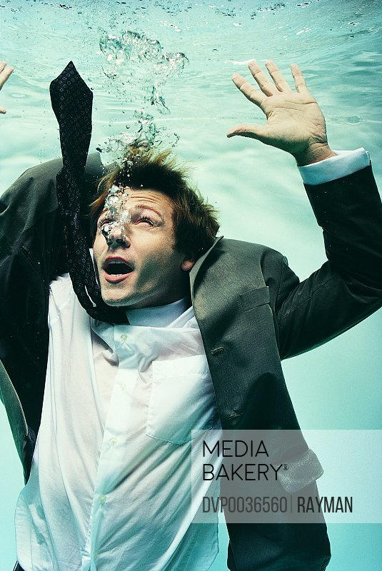 Struggling Businessman Underwater