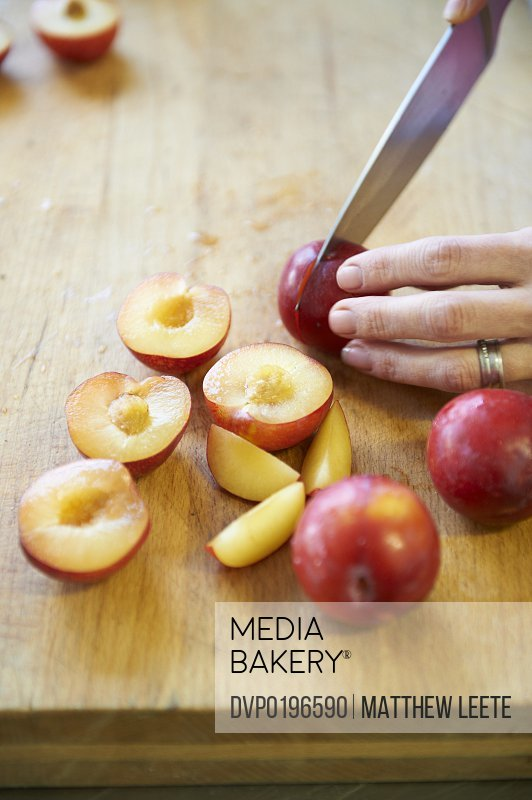 chopping plums