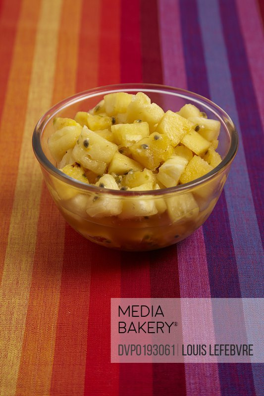 Pineapple and passionfruit salad with dark rum