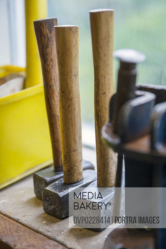 Close-up of hammers on table in fishing industry