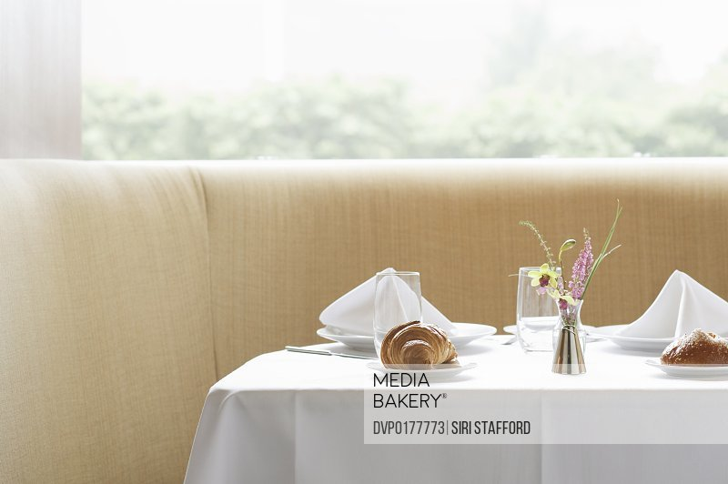 Unoccupied table in restaurant with pastries
