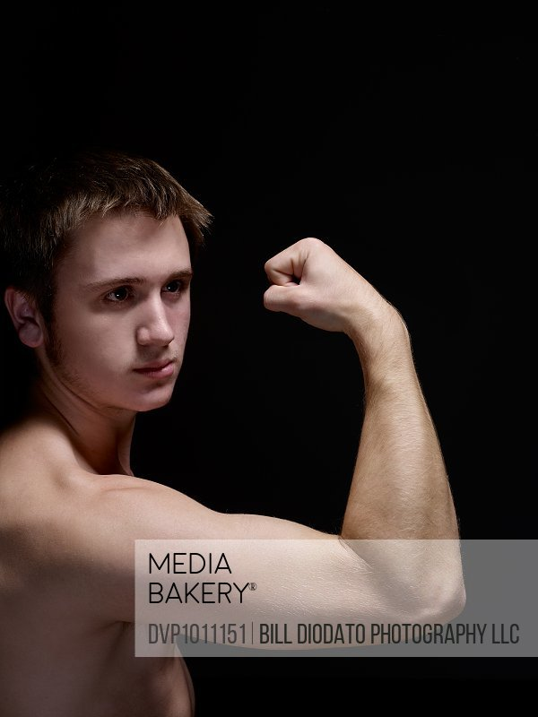young man flexing bicep