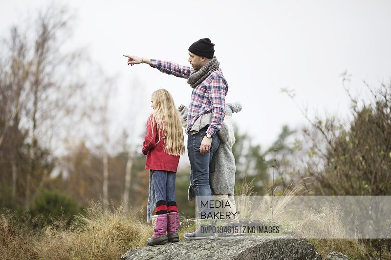 Father and daughters outdoors
