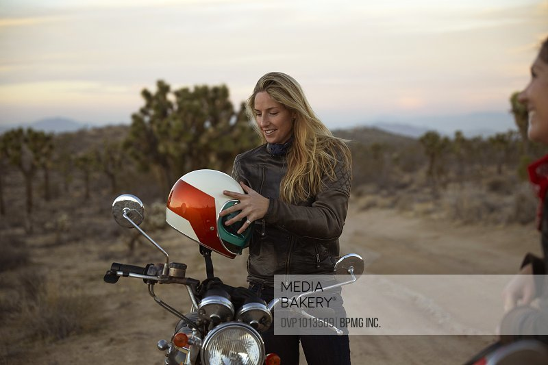 Two young women on an adventure with motorcycles