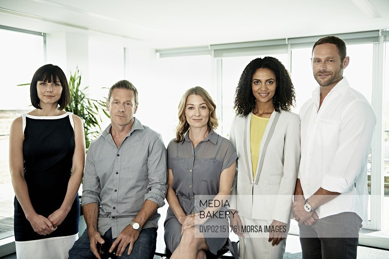 Portrait of smiling business team in a modern office