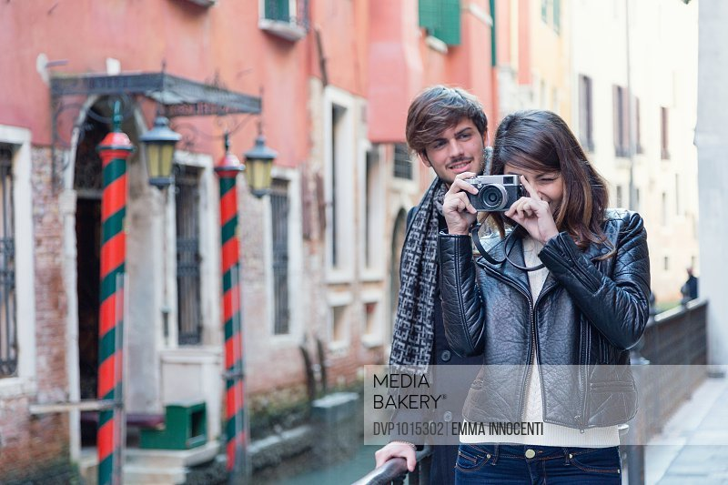 Couple on honeymoon near canal in Venice