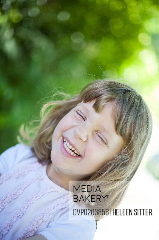 girl laughing hard with closed eyes