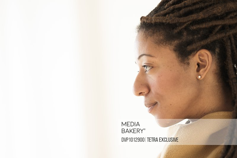 Woman with dreadlocks on white background