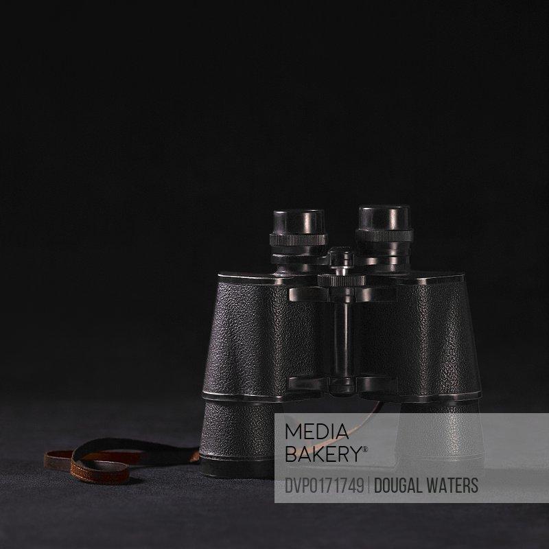 Vintage binoculars on black background