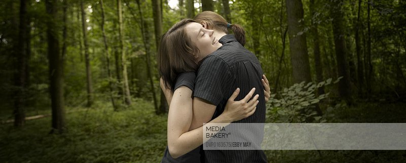 Young couple caressing deep in the woods