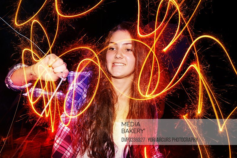 Cropped shot of a teenage girl playing with a firework