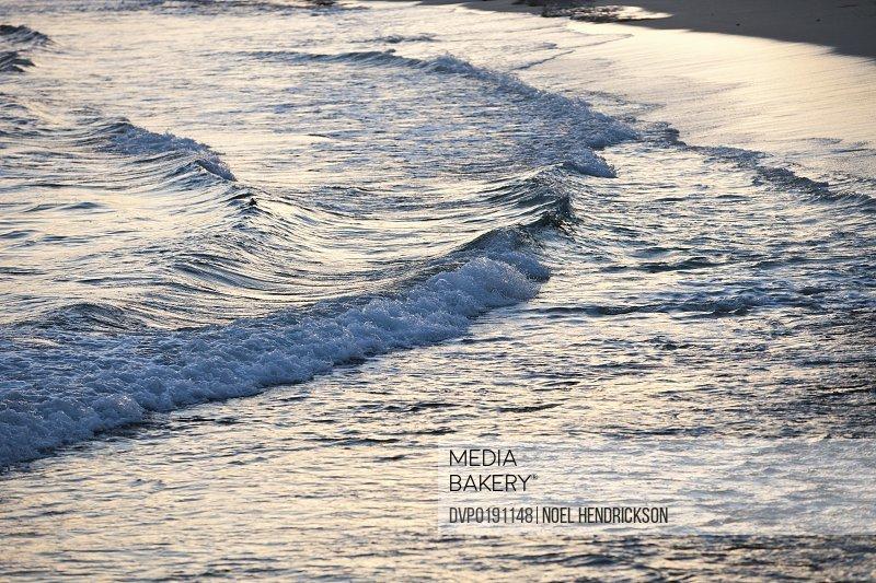 Waves break on a sandy beach