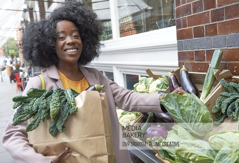 Young woman shopping for fresh produce.