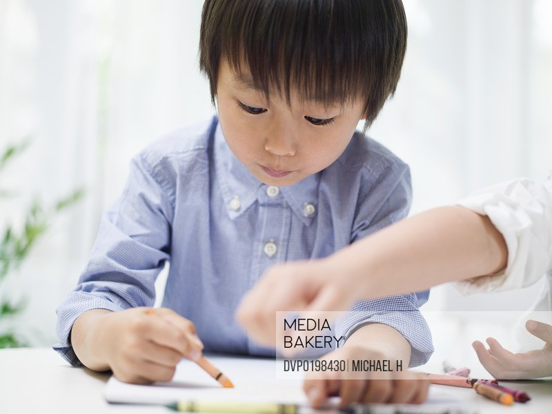 Children drawing with crayon