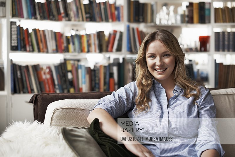 Portrait of smiling woman in her cozy loft apartment