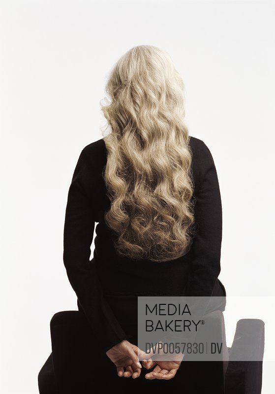 Rear View of a Senior Woman with Long White Hair